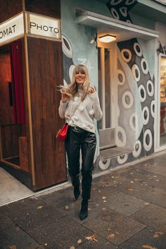ca4af43bc63 Wearing this cute and cosy pom pom sweater with fake leather pants which  looking confusingly similar to real leather.  streetstyle  knit  cosyknit   sweater ...
