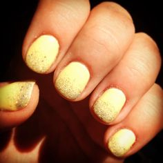 Yellow shellac manicure with glitter fade