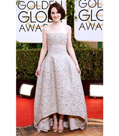 @Who What Wear - WHO: Michelle Dockery WHAT: Actress on Downton Abbey, nominee for Best Television Series Drama. WEAR: Oscar de la Renta dress; Bulgari jewelry; Judith Leiber clutch; Christian Louboutin heels.