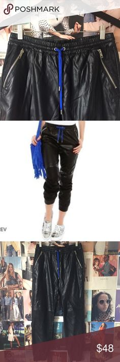 BLANKnyc + Face Lift Vegan Leather Track Pants Equally cool girl vibey with metallic sneaks or stilettos, these joggers are comfortable and versatile. Pull the legs up (as pictured) and sweats go from ho-hum to haute couture! Well, haute couture-ish ha!! Soft on the inside, 2 side zip pockets, one back zip pocket, elastic waist with blue drawstring. NWT. BLANKnyc Pants Track Pants & Joggers
