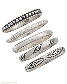 Five stackable Sterling Silver Rings etched with unique designs. Whole sizes 5-11.