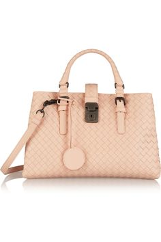 Arm Candy  A richly textured blush-toned leather bag pairs well with any ensemble.