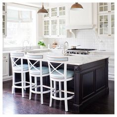 Kitchen inspiration. White cabinets and tile. Expresso island. Baby blue chairs.