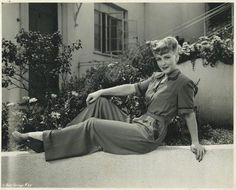 1940s- I like her outfit and shoes, and really like the house in the background (it's clearly California!)