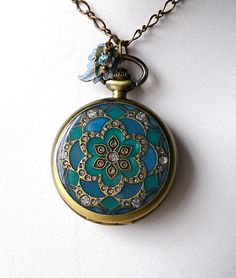 Teal &  Emerald Mandala Pocket Watch Locket Pendant with Matching Earrings and Tool. $32.50, via Etsy.