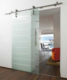 Instead of the sliding barn door this would actually be a great contrast to all that wood paneling. Modernize and brighten!