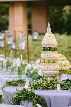 Tall Fruit-Inspired, Floral Arrangement | Photography: Brian Leahy Photography. Read More: https://www.insideweddings.com/news/travel-honeymoon/say-i-do-and-honeymoon-at-one-of-balis-most-luxurious-resorts/3222/