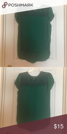 Green blouse This green blouse with mesh triangle detailing is perfect for a day out on the town or a day of hard work in the office. Tops Blouses