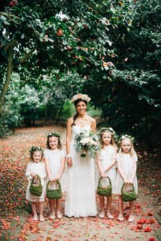 sweet flower girls carrying their BHLDN moss baskets | via: style me pretty