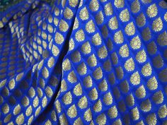 This is a beautiful pure benarse silk brocade floral motifs design fabric in Dark Blue and Gold. The fabric illustrate small golden woven motifs on Blue background.    You can use this fabric...