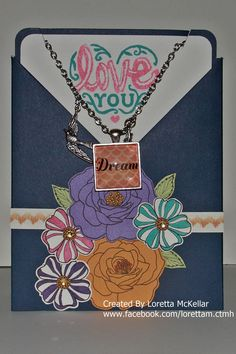 This is a Necklace Card and Base and Bling Necklace made by Loretta McKellar using Close To My Heart Products. It is made using Sarita paper, Alcohol Markers, Card Word Puzzle and Cloud Nine Card Kit Stamp Sets.
