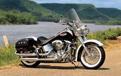 One of Daddy's mid-life toys! A 2007 Harley-Davidson Softail Deluxe. Don't get to ride much these days but I almost get as much pleasure out of just sittin' in the garage polishing up the chrome. A real piece of art!