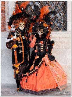 Venetian Carnival Masks   ... : Venice, Carnival 2011: The black and orange masks - Magnificent