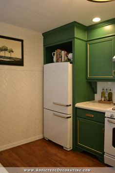 My Kitchen - Nine Things I Would Do Differently - Addicted 2 Decorating® - space above refrigerator