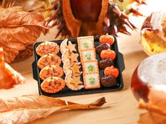 Miniature Food -  A lovely selection of Halloween / autumn themed cookies, candies and treats presented on a black metal baking tray.  Includes:  ● Jack OLantern cookies ● Moon and star cookies ● Green frog cookies ● Chocolate and orange candy Jack OLanterns  Handcrafted in France.  Find @parisminiatures on ● Instagram ● Facebook ● Twitter
