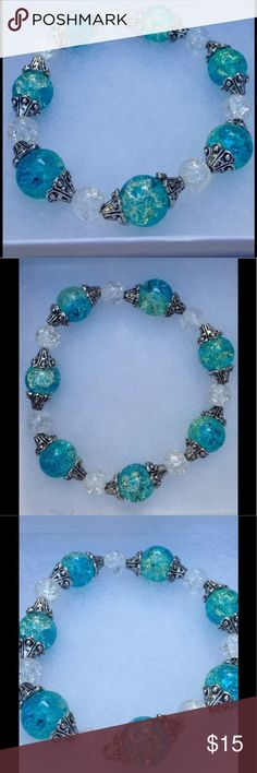 "Green And White Glass Bracelet This pretty bracelet is made with sparkling green-blue and white glass beads. It is on elastic and will stretch to fit up to an 8"" wrist.   All PeaceFrog jewelry items are handmade by me! Let me know if you need a different size. Take a look through my boutique for coordinating jewelry and more unique creations! PeaceFrog Jewelry Bracelets"