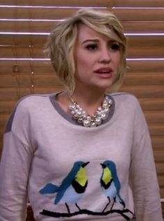 Chunky necklace and bird sweater