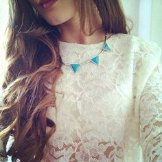 Girlish look. Curls, lace and a touch of blue.