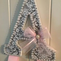 Super cute gray damask, pearl border, pink tulle with rhinestone embellishment and pink ribbon  Barrette and Headband holder. Can make custom colors