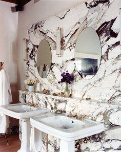 A marble wall behind the sink