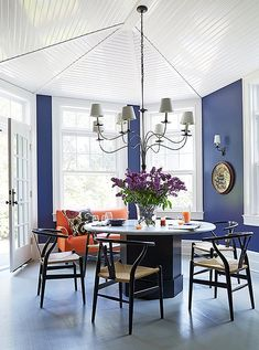 Black chairs by Hans Wegner tie back to the black base of the table Mele had made for the breakfast room.