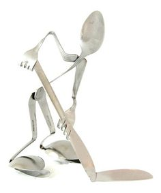 Top-shelf style. Fresh and funky, this clever figurine was crafted from stainless steel utensils for a cool eclectic vibe.