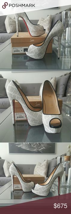 Christian Louboutin Lady Peep 150 Panama Damier White Cross stitch with black piping. I've only worn them once. Comes with dust bag, extra tap, and box. White just isnt my color, that's the only reason im selling them. Reasonable offers are welcomed. Lower on Mrcari. Christian Louboutin Shoes Heels
