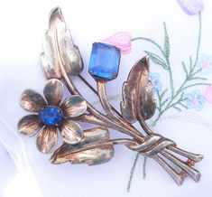 Your place to buy and sell all things handmade Retro Flowers, Vintage Jewelry, Unique Jewelry, Silver Brooch, Blue Crystals, 1940s, Sterling Silver Jewelry, Gifts For Her, Antique