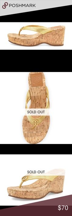 "Sold out TORY BURCH GOLD SUZY CORK WEDGE TORY BURCH GOLD SUZY CORK WEDGE LOGO SIZE 9.  Worn a couple times.  Original Price: $235.                Tory Burch snake-print metallic leather sandal.  Double-T logo medallion at center of thong strap.   3"" cork wrapped wedge; 1"" platform; 2"" equiv.   Padded cork insole.""Suzy"" is made in Brazil. Shoes Wedges"