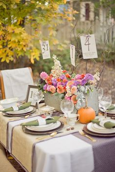 Lovely outdoor tablescape, highlighting natural elements and textures.