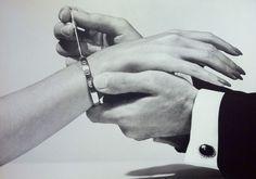 Aldo Cipullo's iconic L⊖VE bracelet (for Cartier). Photographer unknown. #aldo_cipullo #love #bracelet #bolts #cartier #jewellery #permanent #hands