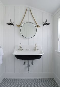 Vertical Shiplap Bathroom Black And White Cottage Bathroom Features Walls Clad In Vertical Lined With A Rope Hung Mirror Illuminated By Black And White Vintage Barn Wall Vertical Shiplap Bathroom Wall Shiplap Bathroom Wall, Bathroom Feature Wall, Pool Bathroom, Bathroom Black, Attic Bathroom, Bathroom Fixtures, Trough Sink Bathroom, Seaside Bathroom, Lake House Bathroom