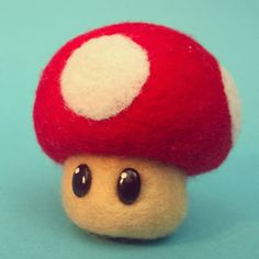 DIY needle felt Mario Mushroom. Just finished this Mario Mushroom made by needle felting. I'm really pleased with how it turned out. Love the polymer clay eyes aswell.