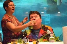John Horne, owner of Anna Maria Oyster Bar, eats a hunk of lettuce handed to him by a volunteer. Horne and four other community leaders participated in a lettuce-eating contest to celebrate Snooty the manatee's upcoming 66th birthday. Each participant was given five pounds and had 10 minutes to eat as much as they could. (Staff photo / Shelby Webb)