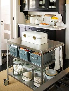 Island Storage - I ADORE this look! Kitchen island carts serve a dual purpose as prep space and storage space. Outfit cart shelves with bins for items such as potatoes and onions, and jars for dry foods such as rice and beans. Kitchen Pantry, New Kitchen, Kitchen Dining, Kitchen Cabinets, Kitchen Ideas, Organized Kitchen, Kitchen Organization, Kitchen Storage, Storage Spaces