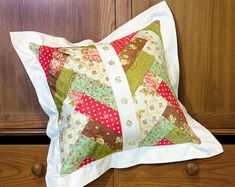 cute pillow design with strips http://www.sew4home.com/tips-resources/fabric-color-texture/lesson-pre-cut-bundles-common-names-sizes-and-shapes