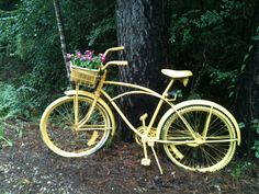 Paint your old bike, fill basket with flowers, put in garden, nice.