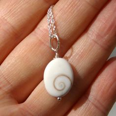 Spiral Cat Eye Shell Eye of Shiva Necklace by HaoleGirlHaiku Available on www.Etsy.com/shop/HaoleGirlHaiku