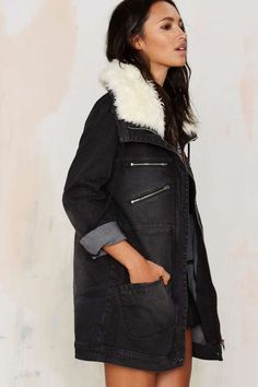 The Thrills Parka is made in faded black denim and features two zipper and two slanted patch pockets at front, button closures at cuffs and a faux fur collar.