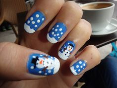 Blue christmas nail art design with snowflakes and snowmans