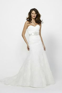 Ivory tulle strapless gown with a sweetheart neckline, all over hand crafted graphic detail, slight fit and flare skirt. Chapel train. Shown with belt style 1908B Marlene (sold separately).    Sizes: 0-24    Colors: Ivory    Fabrics: Tulle    Available Colors: WHITE, IVORY