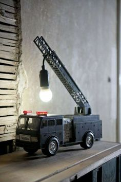 repurposed firetruck toy, turned into a lamp. Blue Velvet Chair: A Day's Worth of DIY Inspiration - Repurposed