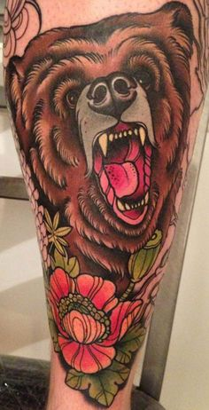 Traditional bear & floral tattoo