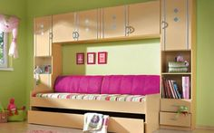 Like the cabinets above and the wall couch idea just take away the little kid look and it is a great idea for my dream bedroom!
