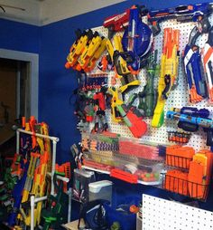Nerf Gun storage - notice the lean-to style rack in the bottom left corner Nerf Birthday Party, Nerf Party, Kids Storage, Toy Storage, Storage Ideas, Toy Story Zimmer, Nerf Gun Storage, Toy Story Room, Toy Rooms