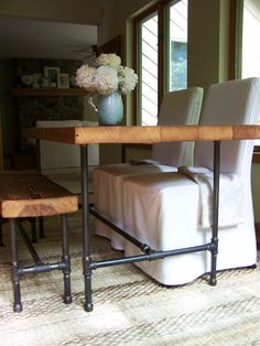 """Reclaimed Wood Table with industrial pipe legs. 60"""" l x 30"""" w x 30"""" tall (100-150 year old growth wood). $1,050.00, via Etsy."""