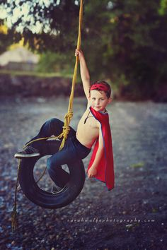 Super boy on a tire swing