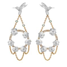 The chandelier earrings from Theo Fennells new Hummingbird and Hibiscus Suite in 18ct white gold, set with luminescent Paraiba tourmalines (£8,750).
