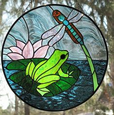 Stained glass frog and dragonfly suncatcher by livingglassart home of oddballs and oddities, via Flickr