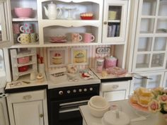 I heart miniature kitchens. My favorite room of a dollhouse :) This is 1:12 scale